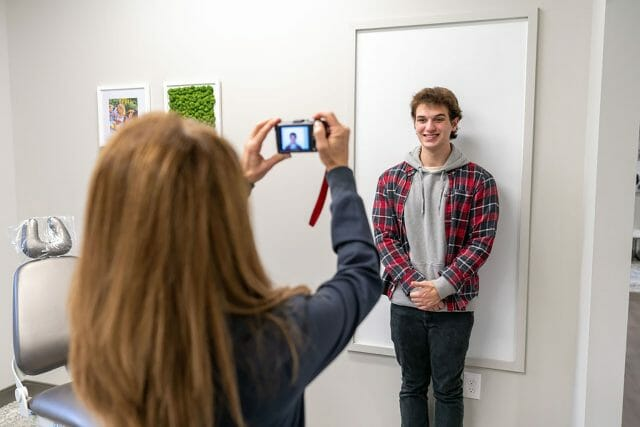 Young man getting his photo taken at dentist office